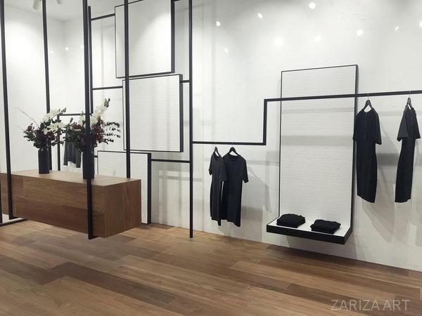 интерьер салона одежды стены из плитки